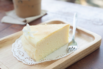 Japanese cheese cake on wooden plate