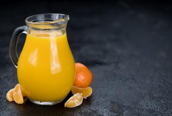 Fresh made Tangerine Juice (close-up shot)
