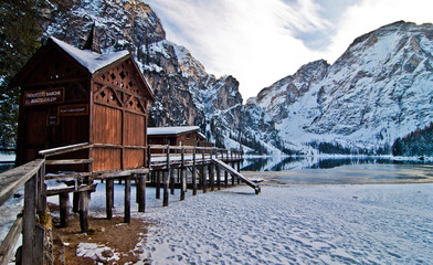 small house on mountain lake