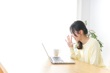 Young woman doing desk work