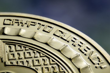 """Makro view of """"Crypto currency"""" sign on gold coin"""