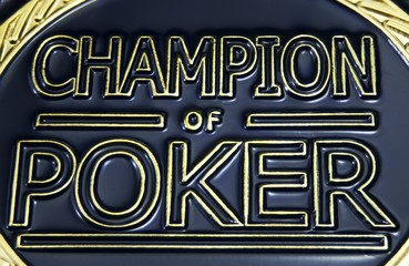 Makro view of label Champion of Poker on gold coin chip