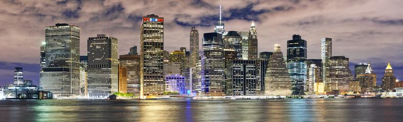 New York City skyline panorama at night, USA.