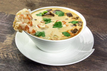 Tom Yam, traditional Thai soup with shrimps and mushrooms, closeup