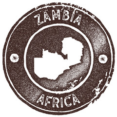 Zambia map vintage stamp. Retro style handmade label, badge or element for travel souvenirs. Brown rubber stamp with country map silhouette. Vector illustration.