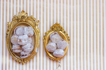 Homemade vanilla cookies served on vintage picture frame or trail, copy space