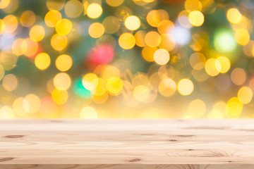 Wall Murals Christmas Blur Bokeh with wooden background with copy space for shopping store or display promotion products in New year holiday sale.