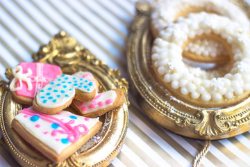 Close up of homemade  Christmas or winter theme cookies, served on vintage golden picture frame or trail