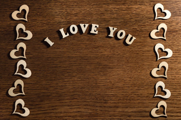 inscription I Love you on wooden background
