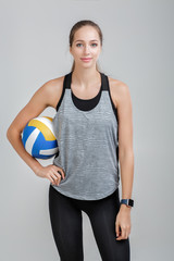 sports woman holding a volleyball