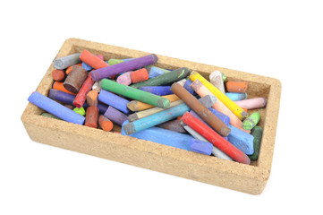 Pastel crayons in box on white background