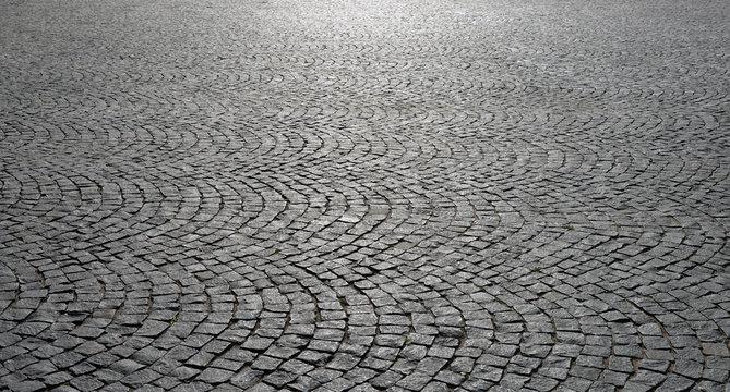 Old cobblestone pavement close-up.