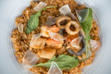 Risotto with seafood on white plate