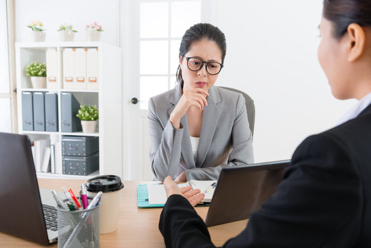 young company woman boss looking at document