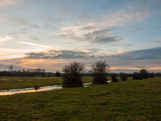 empty wet grass field low light sunset landscape dedham plain empty no people dramatic sky