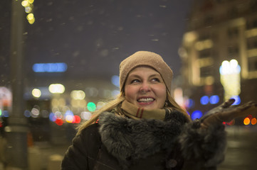 Portrait of happy woman in the night city