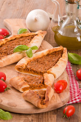 Turkish pide pizza with meat and onion.