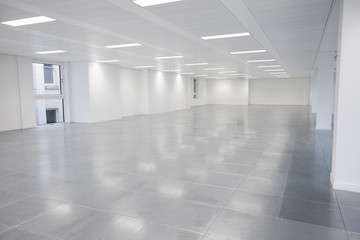 Vacant open plan office space with lights on