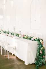 Wedding dining table with floral garland