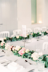 Decorated wedding dining table with floral garland