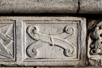 Abstract and geometric stone decorations on the facade of the Duomo of Como. Late Gothic and Renaissance decorations in northern Italy. Ancient patterns and Gothic geometries