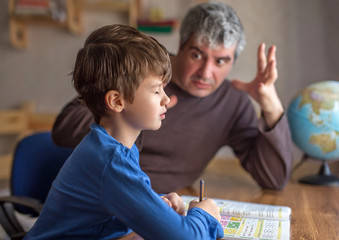 Father explainn mathematics with passion to little son