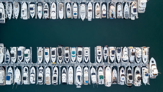 Drone view of a marina with boats and yachts