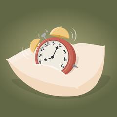 alarm clock on a pillow
