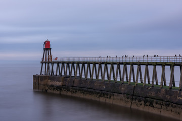 Whitby harbour entrance, east pier and beacon, Yorkshire, UK.