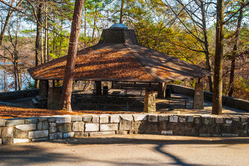 Big picnic area with tables and roof in the Stone Mountain Park in sunny autumn day, Georgia, USA