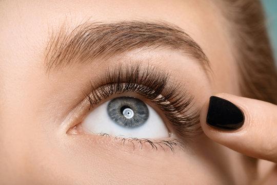 Beautiful female eye with long eyelashes, closeup
