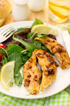 Healthy chicken breasts in honey and soy glaze with garlic