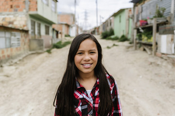 Portrait of beautiful girl in shanty town.