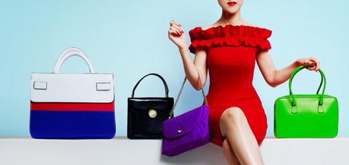 Woman with red dress with many colourful  purses. Fashion handbag, bag images.