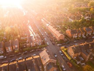 Sun setting over a traditional British neighbourhood. Lens flare and warm colours to give a homely effect. Fotomurales