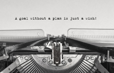 A goal without a plan is just a wish! close up, typed words on a vintage typewriter with vintage background