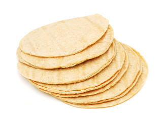 A stack of corn tortillas on a white background