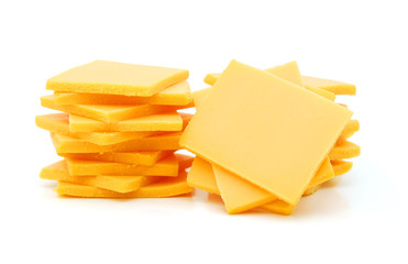 Cheddar cheese slices on white background.
