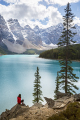 Female hiker looking at Moraine Lake and Valley of the Ten Peaks, Canada