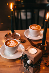 Coffee cups with candle lightings