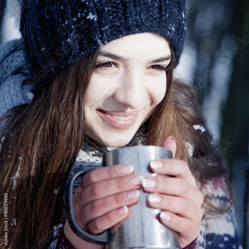 7f62f1abc9199 Happy young beautiful woman drinking hot beverage. Fine winter day. ( Christmas