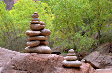 Stacked river stones marking the entry to the Narrows in Zion National Park, Utah.
