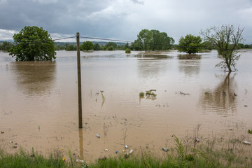Flood water flooded fields and towns. Natural Catastrophe concept.