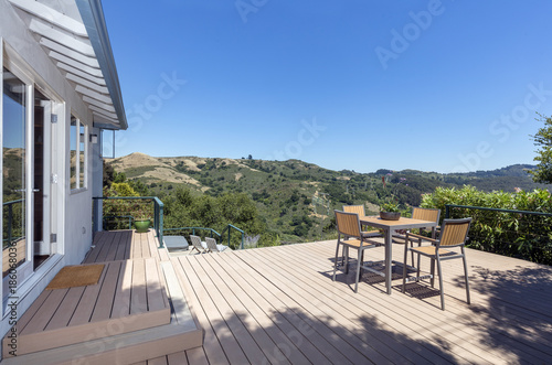 Open Patio Door With New Outdoor Patio / Wooden Deck With Outdoor Furniture  And Mountain View