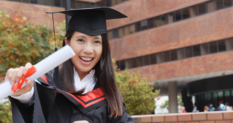 Excited Woman with graduation gown