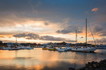 Stykkisholmur harbour at sunset. Stykkisholmur is a town situated in the western part of Iceland, in the northern part of the Saefellsnes peninsula Wall mural