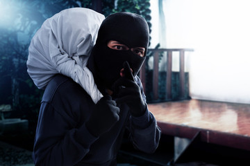 Masked thief stealing