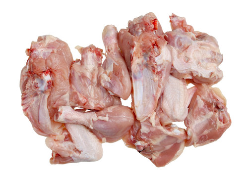 A lot of pieces of raw chopped chicken meat with bones