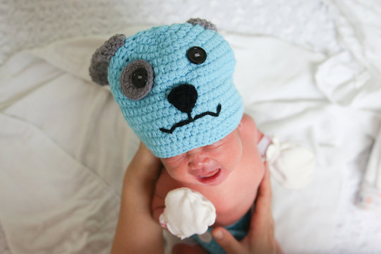 A newborn baby wearing a dog costume to celebrate the New Year of the Dog is pictured at the nursery room of Paolo Chokchai 4 Hospital in Bangkok