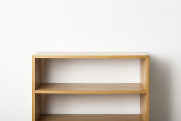 empty solid wood shelf isolated the white background.
